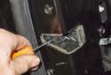 Then install the door handle trim and door handle in the reverse order of removal.