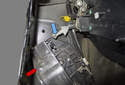 Then remove the door latch from the door by rotating the bottom toward the door skin and feeding the top out of the lock cylinder rod (blue arrow).