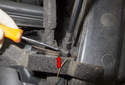 Hood Support Struts: Working at the bottom of the support strut, lever the bottom retaining clip down to disengage it.