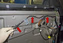 Detach the wiring harness from the mounting points (red arrow) along the top of the door.