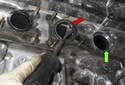 Working at the exhaust ports on the cylinder head, remove the exhaust sealing gaskets (red arrow).