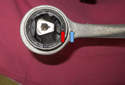 Be sure to align the bushing notch (red arrow) with the nub (blue arrow) on the tension strut when installing.