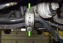Front sway bar: Working at the left side sway bar bushing, remove the two 13mm sway bar bushing fasteners (green arrows).