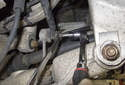 Rear sway bar links: Working at the sway bar, loosen the 16mm end link nut while counter-holding the T30 Torx in the center of the stud.