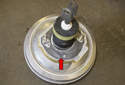 If reinstalling or dealing with a water leak, replace the brake booster seal (red arrow).