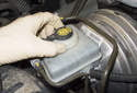 Make sure to clean around the brake fluid reservoir cap before removing it, as you do not want to get any dirt into the reservoir.