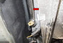 Replacing: Next, use a 19mm (red arrow) wrench and loosen the switch.
