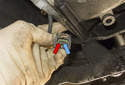 Testing: If the lights do not illuminate, check the electrical connector power (blue arrow) and ground (red arrow) supply.