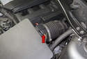 The mass air flow sensor (red arrow) is located at the air filter housing outlet on the left side of the engine.