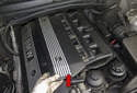 Slide the intake cover (red arrow) toward the right side of the engine and remove.