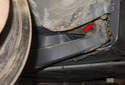 The rear trailing arm bushing (red arrow) connects the rear trailing arm to the body.