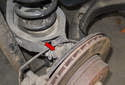 The rear ball joint (red arrow) connects the rear upper control arm to the rear wheel bearing carrier.