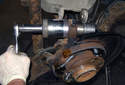 Assemble ball joint tool and new ball joint to install ball joint into wheel bearing carrier.