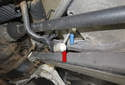 Rear sway bar links: The rear sway bar link connects the rear swing arm (red arrow) to the sway bar (blue arrow).