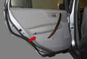 The rear interior door trim panel (red arrow) has to be removed to access components behind it, such as the door speaker, door glass, window regulator and door latch.