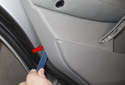 Using a door panel clip tool, release door panel clips (red arrows).