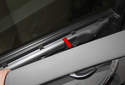 Once door panel clips have been disconnected, lever the top of door panel (red arrow) off the door.