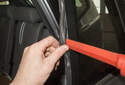 Pinch the window seal and pull out, use a plastic prying tool to hold it out as you work your way up detaching it.