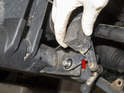 Remove the sensor (red arrow) from the control arm bolt.