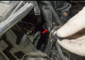 High Beam: To remove the bulb (red arrow), simply pull it out past the spring.