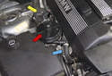 An electric air pump (red arrow) forces fresh air into the exhaust stream just before the exhaust enters the exhaust manifold (blue arrow).