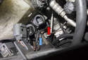 To replace the windshield or tailgate washer pump, locate the electrical connector for the pump you want to replace.