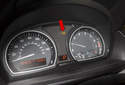 The brake pad warning light (red arrow) will be on when the sensor is seen to be open, or worn out.