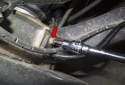 Rear sensor: Working at the trailing arm, remove the ABS sensor 5mm Allen fastener (red arrow).