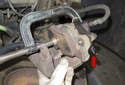 Press piston back into caliper using a brake caliper piston tool or a C-clamp.