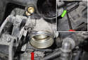 Next, disconnect the throttle housing electrical connector by pressing the release tab (red arrow) and pulling it off the housing.