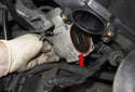 Remove the throttle housing from your engine.