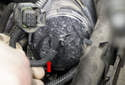 Pull the vacuum reservoir up enough to remove the front vacuum hose (red arrow).