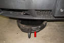 Place a drain pan under the right side of the front bumper, below the sensor (red arrow).