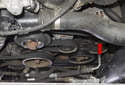 The alternator on BMW X3 models with a M54 6-cylinder engine is located on the left side of the engine (red arrow).