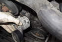 Accessory belt tensioner: Remove the tensioner from the engine.