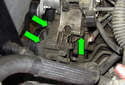 Remove three power steering pump 13mm fasteners (green arrows).
