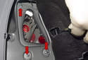 To remove the tail light from vehicle, start by removing the three 10mm mounting nuts (red arrows).