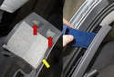 Using a trim panel tool, unclip the left side C-pillar trim (yellow arrow).