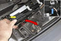 Remove the latch from the body by pushing the bracket (yellow arrow) away from the latch and feeding the latch out (red arrow).