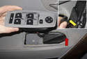Release the third tab at the front of the switch (red arrow), then slide it out toward rear of vehicle.