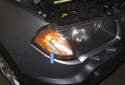 An indicator of a problem with the headlight switch would be non-functioning headlights with an illuminated instrument panel and parking lights (blue arrow).