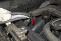 Pull the oxygen sensor harnesses out of the mounting clip at the rear of the intake manifold.