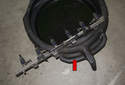 Allow removed fuel rail to drain in a pan (red arrow).