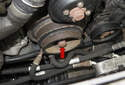 Use a 22mm socket on the crankshaft pulley fastener (red arrow) to rotate engine.