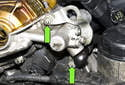 Remove engine hoisting hook fasteners then remove hook from engine (green arrows).