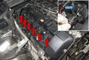 Open all six ignition coil electrical connectors (red arrows) by lifting the connector (blue arrow) up 90°.