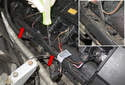 Next, remove the ignition coil wiring harness housing from the valve cover.