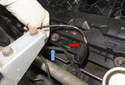 Next, pull the oxygen sensor harness (blue arrow) out of the plastic mount on the valve cover (red arrow); Front mount shown, repeat for rear mount.