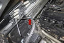 For the rear fasteners, use a long extension and work through the cabin filter flap (red arrow).
