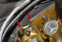 Then apply a small amount of RTV to the points at the camshaft openings at the rear of (red arrows) the cylinder head.